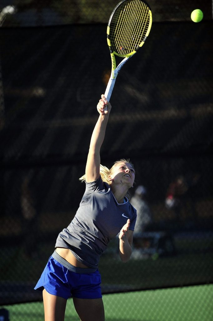 A tennis player making a serve.