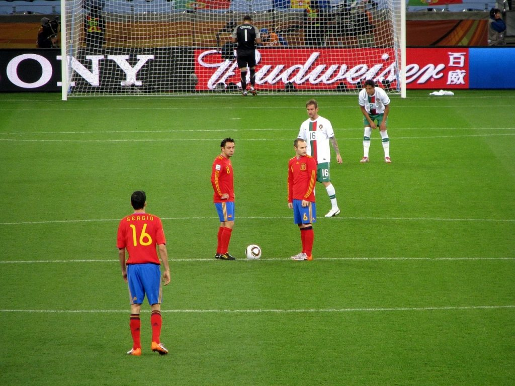 Xavi and Iniesta about to kick off for Spain.