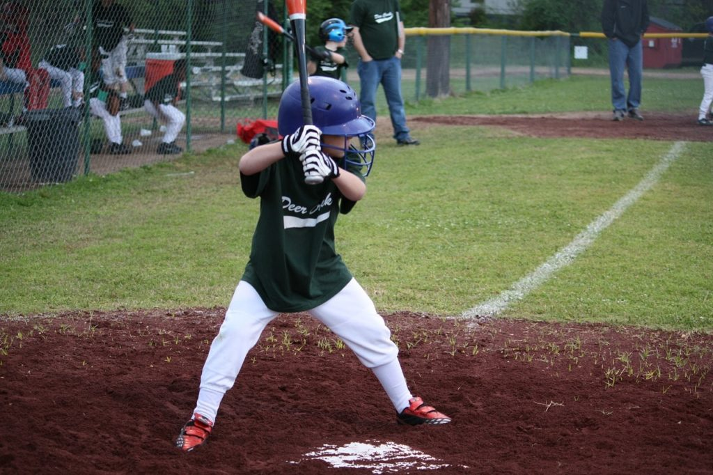 Little League youth baseball hitter.