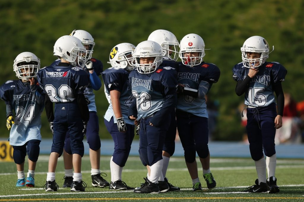 Youth American football players.